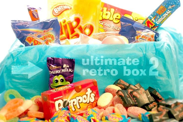 Ultimate Retro Box 2  Each box contains: 1 bag Pear Drops / 1 bag Harribo Jelly Babies / 1 bag Rhubarb & Custard / 1 bag Harribo Heart Throbs / 1 bag Harribo Jelly Beans / 1 bag Rosie Apples / 1 bag Black Jacks / 8 x Anglo Bubbly / 10 x Flying Saucers / 1 x Wham Bars / 1 x Refresher Bars / 1 x Dip Dab / 1 x box Toffee Poppets / 3 x Jazzles / 2 Bags Rainbow Drops / 2 x Chuppa Chupp Lollies / 1 Pack Chewits / 10 x bananas / 2 packs Maoam Chews / 2 x packs Fizz Whizz / 1 x Freddo Frog / 1 x…