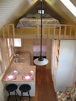 Looks like a 2 bed tiny home...is that a bed in the back? Perfect! Seattle Tiny Homes.