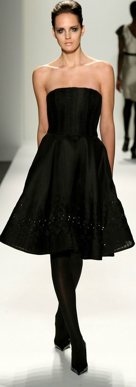 Gorgeous!! All the black with the tights and the shoes make your eye go straight to her beautiful face and shoulders.