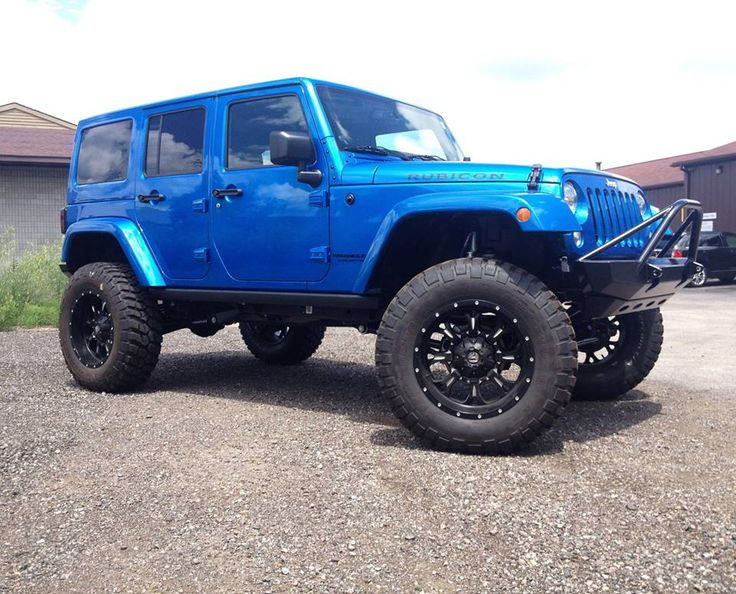 Custom Hydro Blue Jeep Wrangler Rubicon built by Venom Motorsports. Automotive Customizing shop located in Grand Rapids, Michigan. Financing Available