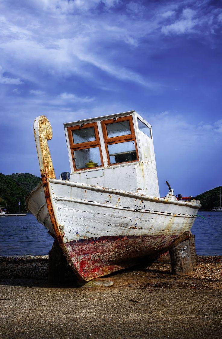 Small fishing boat on shore in Syvota village, Lefkada