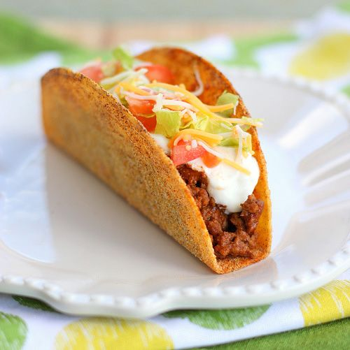 A nacho cheese flavored taco shell filled with taco meat and fixings just like like the one made by that crazy fast food taco shop.