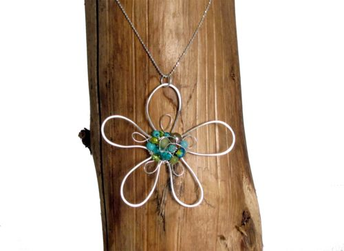 This modern #flower #pendant features a woven cluster of #gemstones and #pearls.  Pendant size: 58 mm. - $59.00
