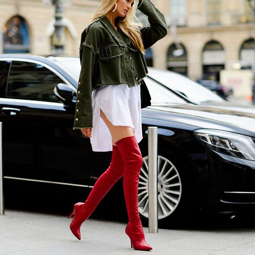 """An over-the-knee boot is a statement piece in its own right, but the Rockoko style from Fendi takes on a whole new level of """"wow"""" in a bright red hue. Team yours with short silhouettes for full effect. - @mytheresa"""