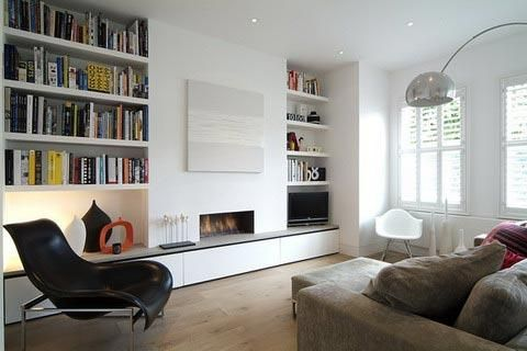 I'm a big fan of built in bookcases  http://shrewt.files.wordpress.com/2011/02/living-room-shelves.jpg
