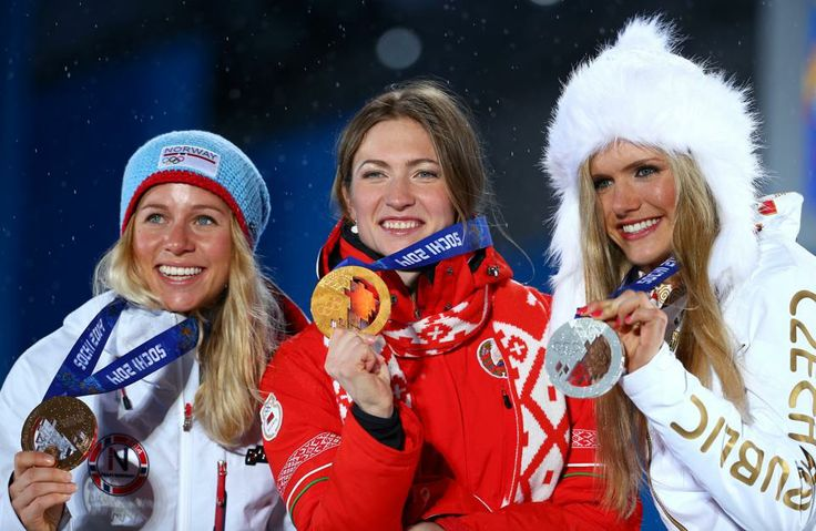 DAY 11:  (L-R) Silver medalist Gabriela Soukalova of the Czech Republic, gold medalist Darya Domracheva of Belarus and bronze medalist Tiril Eckhoff of Norway during the medal ceremony for the Women's 12.5 km Mass Start