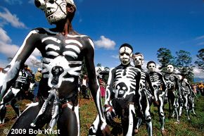 """Huli warriors, Mt. Hagen Cultural Show, Papua New Guinea.     It's a hot, sunny afternoon on this tropical island in the Pacific, and it appears as though I'm in trouble. I've been sitting peacefully on the ground in a field near Mt. Hagen, loading new cards and doing a bit of """"chimping,""""..."""
