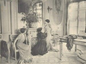 A client trying on gowns at the salon of French couturier Georges Dœuillet, 1910