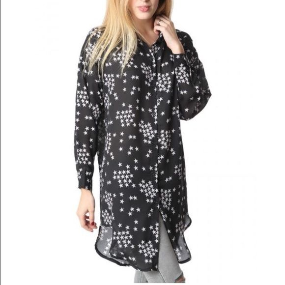 Black Shirt Dress in Start Print What is a shirtdress, you ask? It's literally exactly what it sounds like: a shirt that is long enough to be considered a dress. A typical shirtdress looks like a long button-down shirt, and you can either buy them that way or get creative and make your own out of an over-sized shirt. Tops