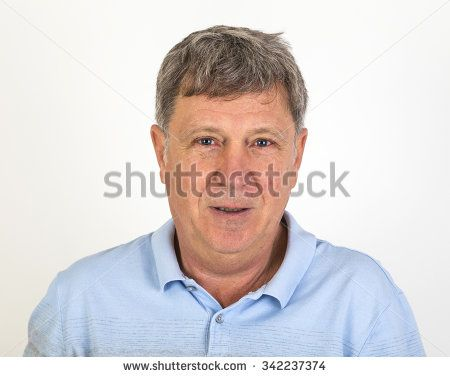 Studio Portrait of a handsome man with grey hair looking to the camera