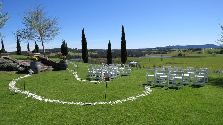 Why have a straight aisle when a  #curved #aisle creates interest, #rosepetals #ceremony #winery #Cupitts