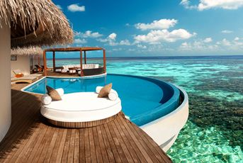 This is the W Maldives.  The hotel actually own the island itself. Your room is glass bottom hut on the Ocean...take me away please!!!!!!