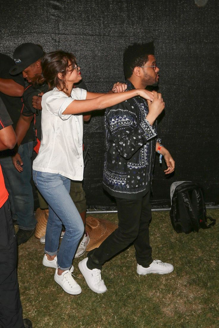 April 14: Selena seen at Coachella with The Weeknd in Indio, California [HQs]