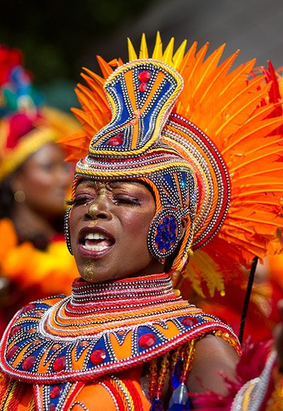 Notting Hill carnival. I love this head dress. looks like a burst of sunlight. i love the blues and the reds too. Sunset / dusk colours