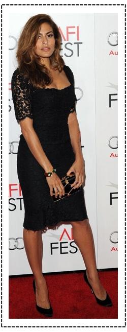 Eva-Mendes looking spectacular in black dress and heels...