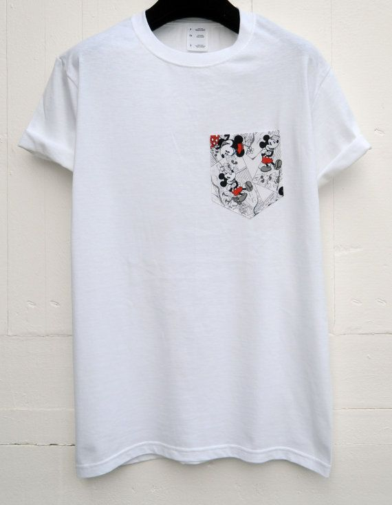 Hand sewn Mickey Mouse design. PLEASE NOTE: MICKEY MOUSE IS FEATURED IN DIFFERENT WAYS ON THE FABRIC. Mens pocket t-shirt using 100% cotton. Fun