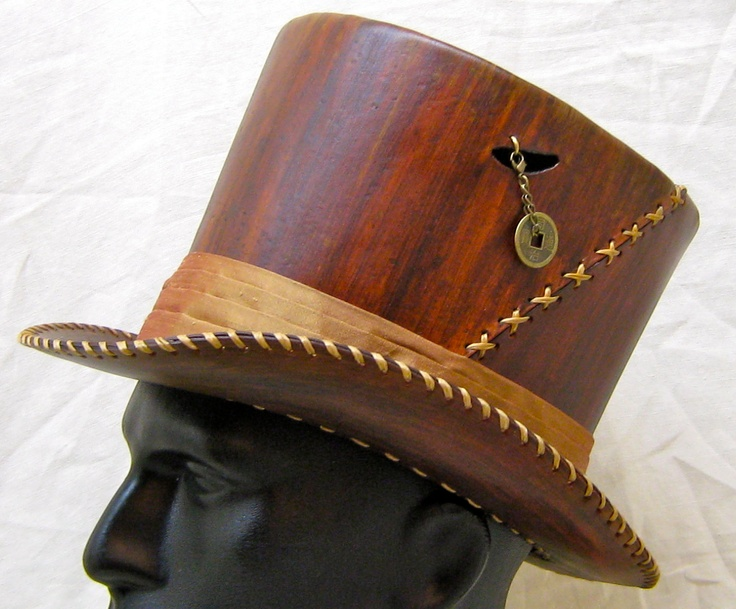 Leather top hat sized for a smaller person. Handstitched and wholly handmade hat.