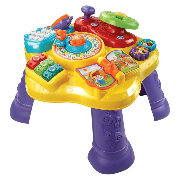 The Magic Star Learning Table™ by VTech® features six fun activities in English and Spanish that encourage your child to explore and learn. Turn the steering wheel to drive the bear around the activity table, flip the book page to hear nursery rhymes and turn the gears to strengthen fine motor skills. Press the light-up music buttons to play music and learn about colors. Then, pick up the pretend phone and press the number buttons to call animal friends. Remove the legs, and the t...