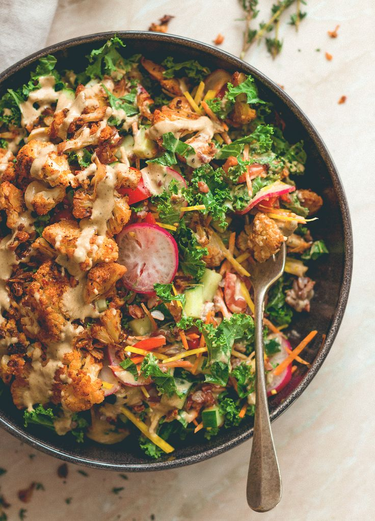 Cajun Roasted Cauliflower Salad - I love cajun seasoning on roasted vegetables. This salad is perfect for this time of the year. Cauliflower, mixed salad, and tahini dressing. (vegan, GF) http://thehe