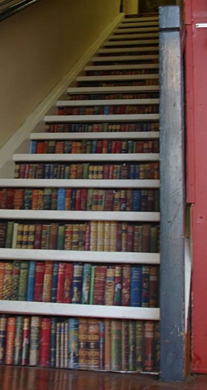 Staircase book decor tis would b kinda cool to have a stair case but it would b a book case