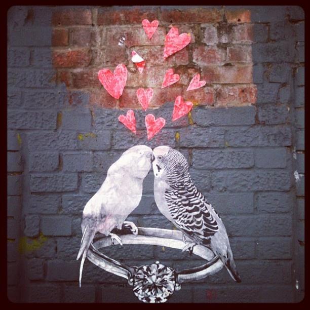 Cute kissing graffiti budgies hidden near Brick Lane. True lovebirds!