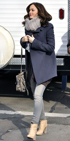 Leighton Meester bundled up in a navy peacoat and faded jeans worn with a gray cowl, a Proenza Schouler bag and Pierre Hardy boots