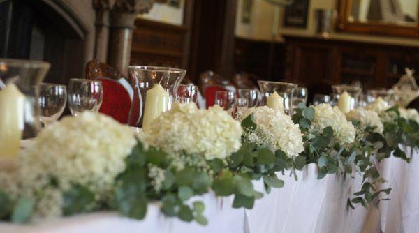 top table wedding flowers full length garland white hydrangeas