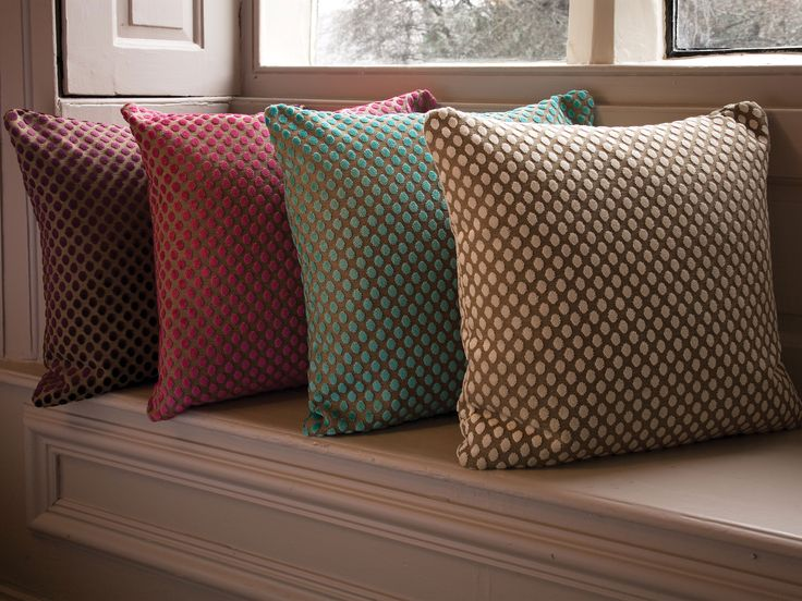 Our range of chenille spot cushions with feather infills. #cosy