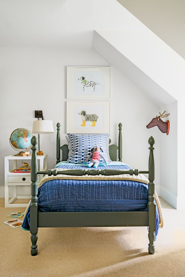 This little boy's bed is painted a handsome shade of gray-green (Rosemary by Sherwin-Williams) that will easily transition from tot to teen. For now, it's right at home alongside a fabric reindeer bust and dapper dog prints.