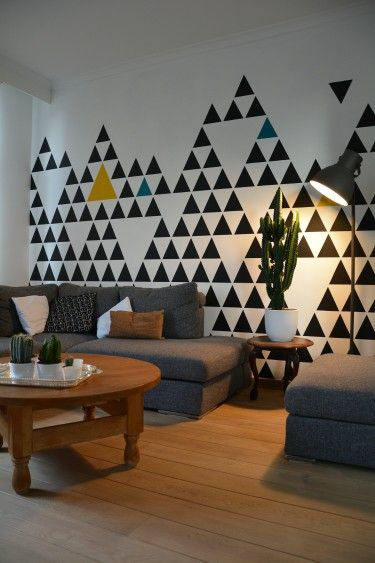 Decor & interior Living room Geometric pattern Black & white painted triangles with a touch of petrol blue and ocher yellow
