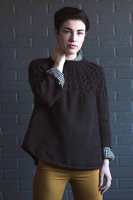 The Angelina Pullover is perfect in its simplicity—style it with a woolen skirt, trousers, or jeans for a versatile fall look. This top-down pullover is worked in the round; the circular yoke features wishbone-shaped cables that increase in size to accommodate the yoke shaping. The sweater also features a curved hem and bell-like three-quarter sleeves.