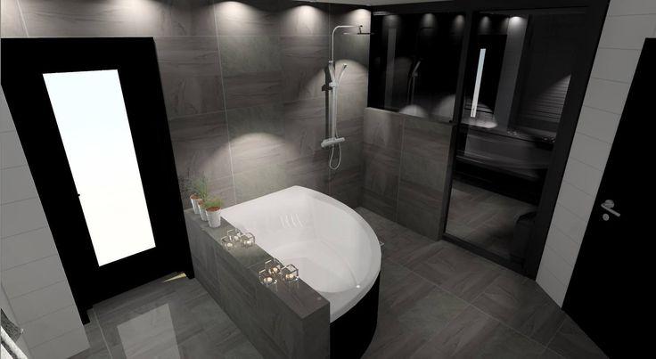 Snyggt badrum med en svart bastu...