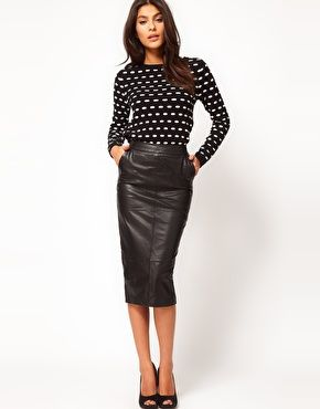 Leather pencil skirt.  Pencil Skirt: A pencil skirt is a slim-fitting skirt with a straight, narrow cut. Generally the hem falls to, or just below, the knee and is tailored for a close fit. It is named for its shape: long and slim like a pencil.  Leather: A material made from the skin of an animal by tanning or a similar process.  (YOLANDE FMM1B2)