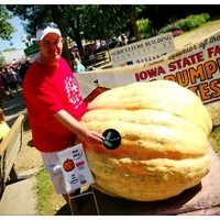Leaders in action: Grand Champion in the Iowa State Fair Biggest Pumpkin Contest. This year's winner was 908 lbs. and was grown by Martin Schnicker of Mount Pleasant. #Leadercast #Leadercastqc #Iowastatefair #giantpumpkin — at Iowa State Fair Grounds.