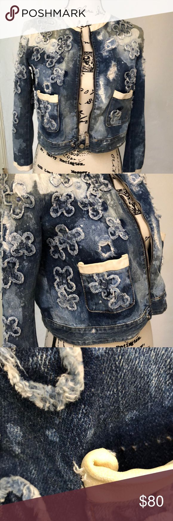 Dsquared distressed denim jacket w leather trim Distressed/destroyed denim w appliqué flowers and white leather trim. Signs of wear: Slight fading of white leather on interior of collar and cuffs. Also one pocket slightly loose. Inner has some marks from self tanner. All of these are pictured here and price reflects this. Made in Italy. DSQUARED Jackets & Coats Jean Jackets