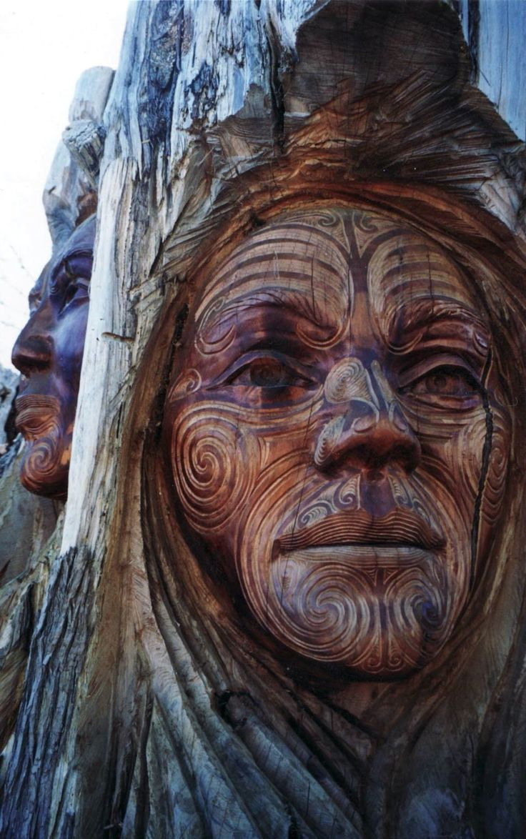 Papatuanuku (Earth Mother) and Ranginui (Sky Father) from Maori tradition carved by Ken Blum and Woody Woodward. Abel Tasman National Park sculpture garden, New Zealand