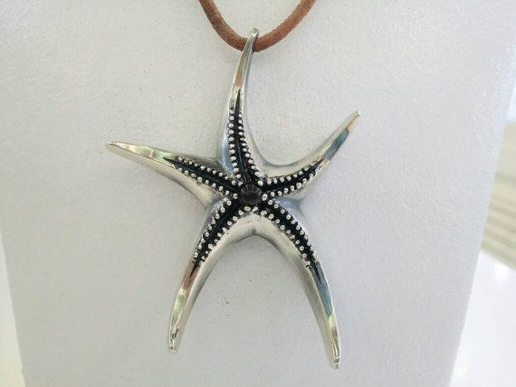 Check out this item in my Etsy shop https://www.etsy.com/uk/listing/457140562/starfish-necklace-in-silver-on-leather