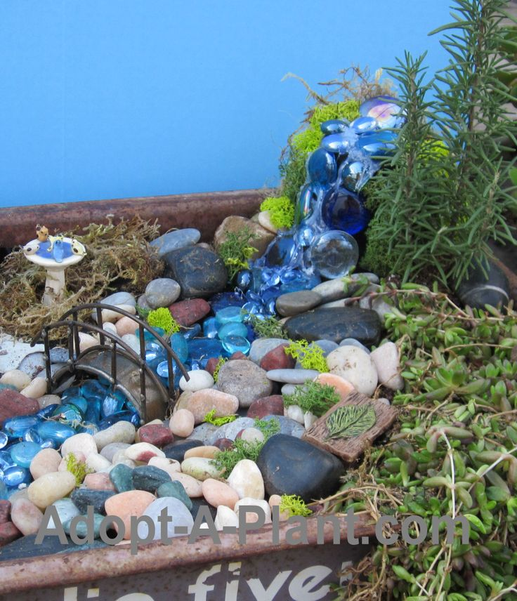 A waterfall for a fairy garden - some big glass stones hot glued onto a terra cotta pot.  Strings of hot glue help create the illusion of water.