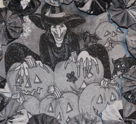 This adorable candle mat is black and grey with a witch sitting with pumpkins. It is round with 13 fabric yoyos that circle the outer edge. The fabric is also glittery, which catches the eye. It is perfect for your favorite Halloween candle or candy dish. It measures approx. 8 across.  This would be a great gift for yourself or a friend.  Safety message: (Im a mom and nurse, humor me) Never leave candles burning unattended especially around children.  Please contact me with any questions…