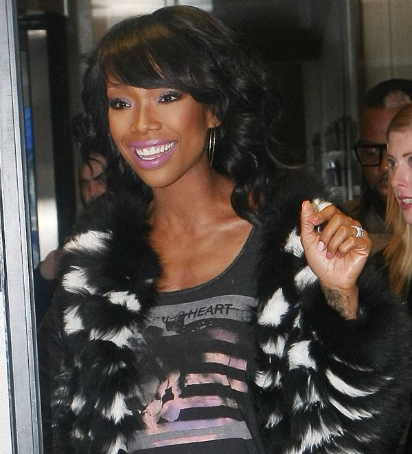 Brandy Norwood wearing a fur jacket from Alice and Olivia