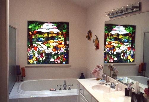 TheTiffany-style nature scene in this bathroom window hides a view of the neighbors garage roof, Oakbrook Terrace, IL