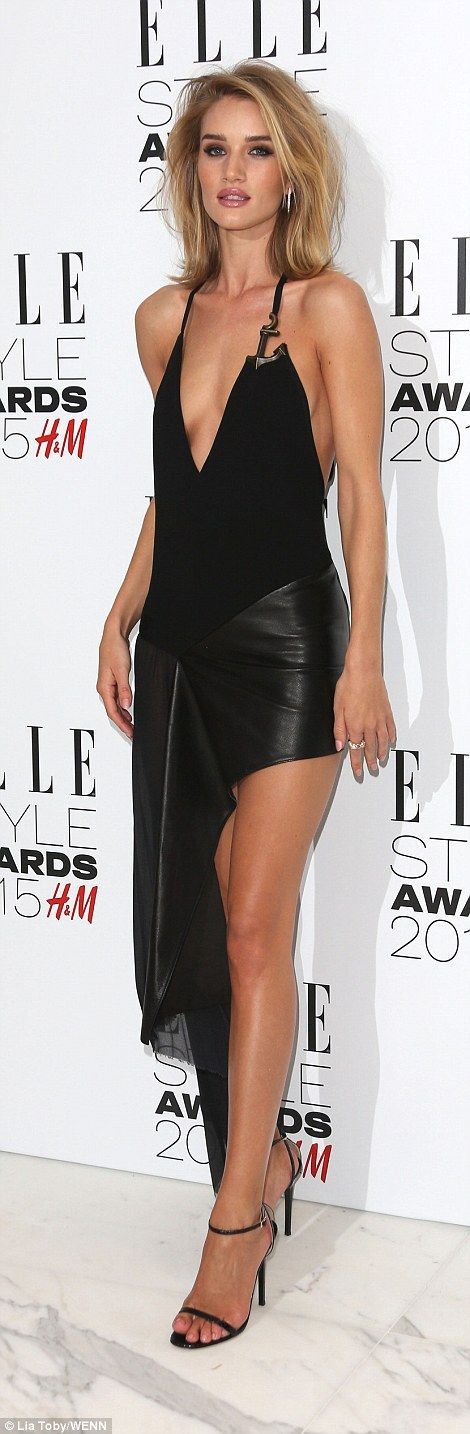 Model Rosie Huntington-Whiteley shows off her sideboob in risqué leather dress as she arri...
