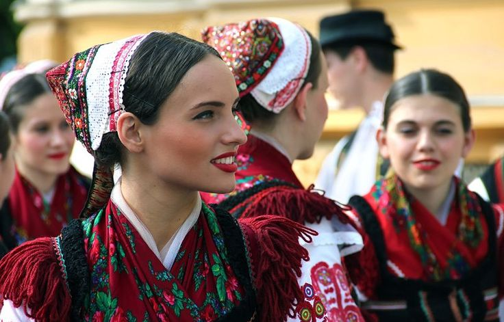Traditional Hungarian attire worn by a beautiful Hungarian young lady.