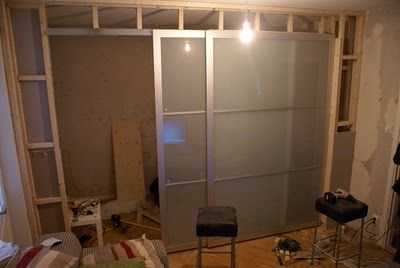 Awesome blog - Ikea Hackers. This person turned a stupio apt into a two bedroom using cheap large Pax cupboard doors from Ikea