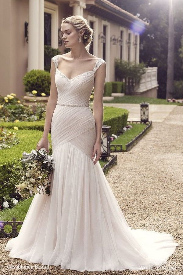 Freesia's breathtaking fit-n-flare silhouette has a bodice with light ruching that makes a flawlessly dramatic transition into the opaque tulle skirt. Exquisitely beaded tank top straps that extend from the sweetheart neckline, and a low back with a sweet detachable ribbon sash, complete the look. | Casablanca Bridal Spring 2016 Wedding Dress