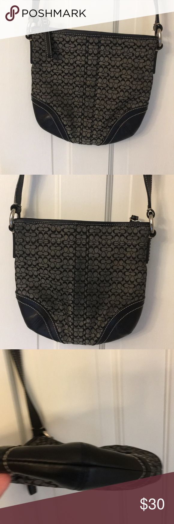Auth Coach Mini Signature Crossbody Swingpack Black and silver mini Signature Coach Swingpack.  Adjustable leather shoulder strap.  Great condition only wear I see is from darkening from rubbing against clothes. Not really noticeable but thought I'd mention. Other than that clean inside and out. No stains, rips, etc Smoke free home Coach Bags Crossbody Bags