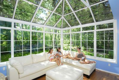 This is such a beautiful sun room! I love how even the roof has windows.This would be the perfect place to relax. You could enjoy the sunlight, while staying plenty comfortable .