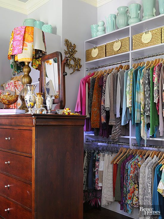 Although it might look like one of those costly storage systems, this closet's shelves and hanging rods were actually built by the contractor during a whole-house remodel, so no extra measuring was required. Lavender paint washes everything with a wink. The girly color makes the space so much flirtier, while a collection of midcentury vases marches across the top shelf (because even closets deserve some decoration.)/