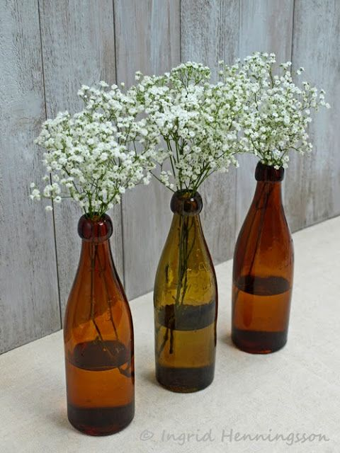"""Beer bottle centerpieces for a """"baby is brewing"""" themed couples baby shower!   #CouplesShower #CouplesBabyShower"""