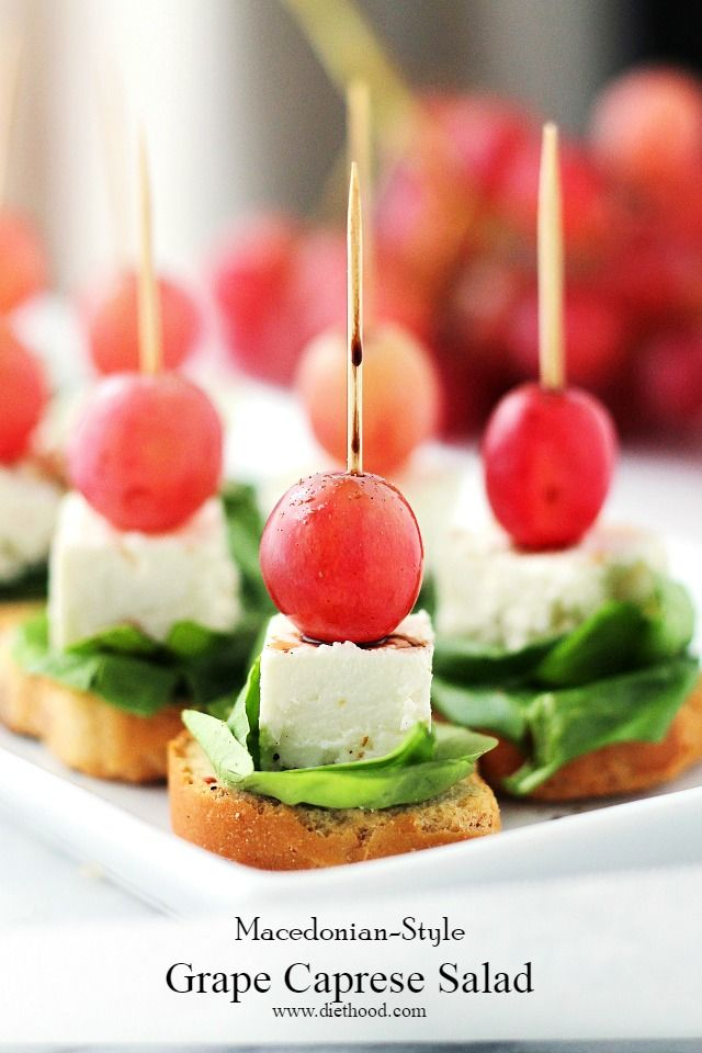 Macedonian-Style Grape Caprese Salad | www.diethood.com | Light, fresh appetizer-salad made with red grapes, feta and spinach set atop slices of garlic toast. | #GrapesfromCA